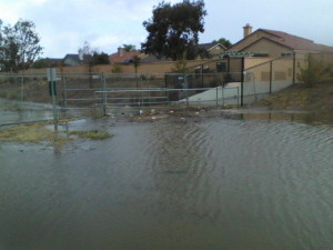 Water accumulated before the bridge to the school.