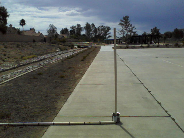 The upright PVC in the can is 20 feet from the centerline of the existing channel near the basketball courts