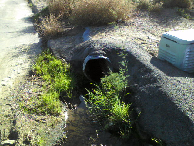An 18 inch line which directs water from a 66 inch culvert onto Lemon St.