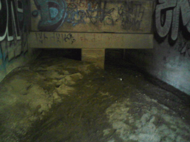 An inside view of the 66 inch culvert. Notice large amounts of sediment ready to move down hill.