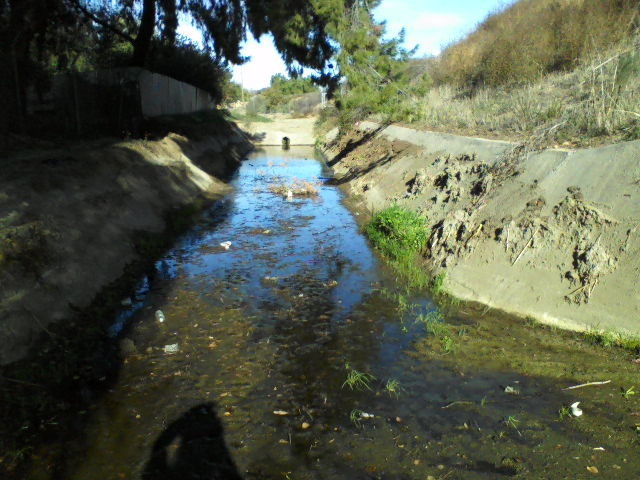 The concrete basin which once filled flows to the above pipe.