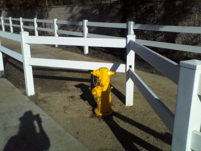 Notice the fence in need of repair. Hope there is not a fire as it appears this hydrant is the culprit of the leak.