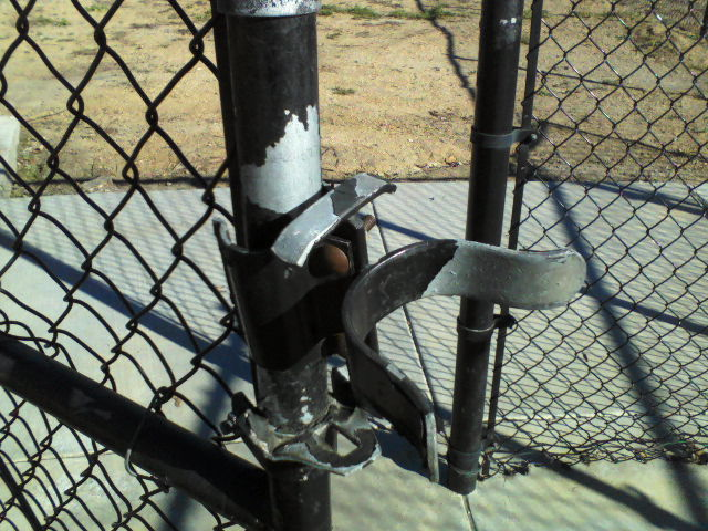 One of four gates with broken latches rendering them unusable